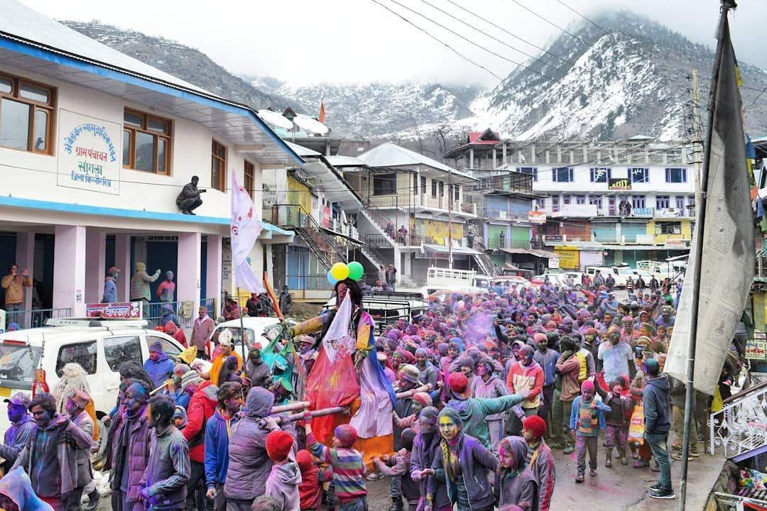 The lively Holi procession in Sangla Valley.