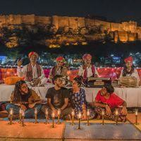 Rooftop music performance overlooking Mehrangarh Fort in Zostel Jodhpur