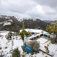 Snow view of common area of our hostel near Nainital