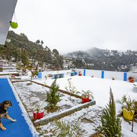 Outdoow common area of our backpacker hostel in Mukteshwar after snowfall