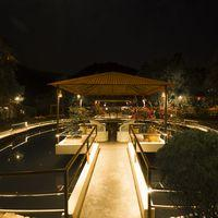 Dine by the waters of the fish pond.