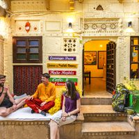 Backpackers chit chatting in front of Zostel Jaisalmer