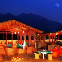 The LIT AF rooftop of Zostel Rishikesh overlooking the Himalayas.