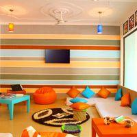 The vibrant TV room of Zostel Rishikesh.