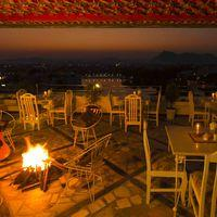 Bonfire at rooftop cafe with Lake view in hostel udaipur