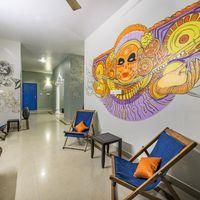 Hostel lobby with local festival murals