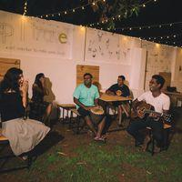 Backpackers enjoying musical evening at hostel