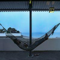 Gaze at the sea as you chill in the hammock on the rooftop.