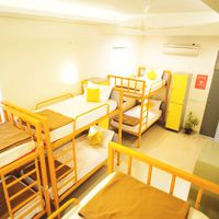 The neat and bright 8-bed dorm
