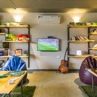 Vibrant common room of Zostel Panchgani