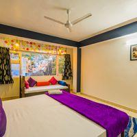 Our colourful deluxe room with natural light.